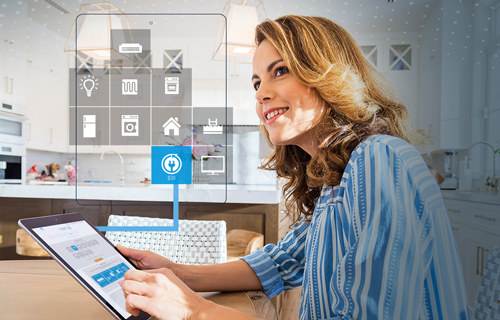 woman using smart home device